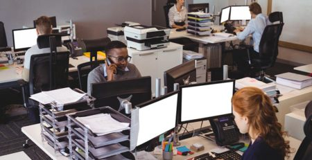 business-people-working-at-desk-in-office